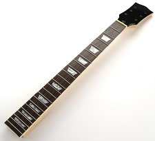 LP Style Maple Neck, rosewood fingerboard. Trapezoid Inlays. Clear Gloss