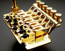 "Gold Floyd Rose ""Fastloader"" Locking tremolo system"